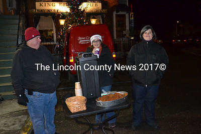 Hot cocoa greeted Wrap It Up shoppers courtesy of King Eider's Pub's Todd Maurer (left), an unidentified expert coffee-drinker (center), and Sarah Maurer (right). (Kim Fletcher photo)