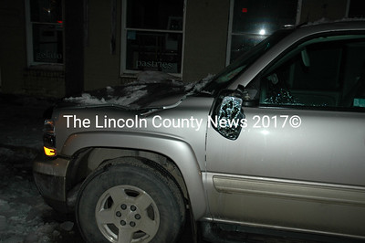 Ice litters Main Street Damariscotta after falling onto two cars around 6:30 p.m. Feb. 7.   Irene Proll's SUV shows the significant damage caused by ice falling from a building on Damariscotta's Main Street Monday night. (Sherwood Olin photo)