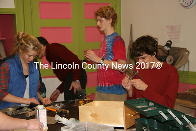Watershed students participate in metal crafting workshop.