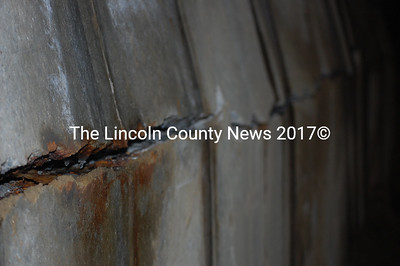 A crack appeared in the concrete wall of the Nobleboro sand and salt shed Feb. 6. (Samuel J. Baldwin photo)