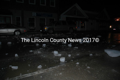 Ice litters Main Street Damariscotta after falling onto two cars around 6:30 p.m. Feb. 7.