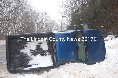 Christopher Pickering, 19, of Bristol, slid around a corner and rolled his 2006 Chevy Colorado on its side during treacherous road conditions Feb. 28. Pickering was not hurt in the accident at the intersection of Rt. 129 and Alice Norwood Road in South Bristol. (J.W. Oliver photo)