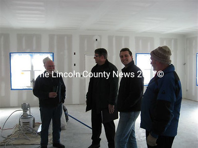 Erik Ekholm, Lynn Talacko, contractor Tom Catalano and selectman Frank Ober (left to right) take in the meeting room of Whitefield's central fire station.