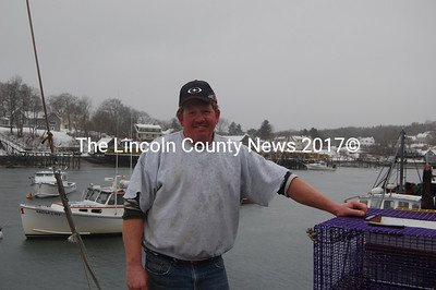Veteran shrimper Bill McLain stands on his New Harbor dock with his boat, the Sheila & Ivy, moored in the background (left). (J.W. Oliver photo)