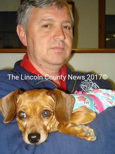 Alna Second Selectman David Seigars and his dog.