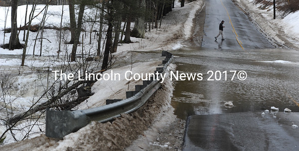 River Road in Edgecomb was closed down Monday morning when a swollen creek flooded over the road, due to a clogged culvet. At least one car stalled out in the high water, which caused a spectacular water fall. (Paula Roberts photo)