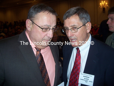 Governor Paul LePage and newly approved Commissioner of the Maine Dept. of Marine Resources Norman Olsen confer at the Maine Fishermen's Forum event March 4. (Kim Fletcher photo)