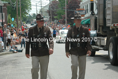 Members of the Lincooln County Sheriff's Office Color Gaurd, Sergeants Dan Sceviour (left) and Jason Nein (right) retrace the parade route. Sceviour was pulling triple duty. He also marched in Waldoboro's parade with the Color Gaurd and then worked the overnight shift.