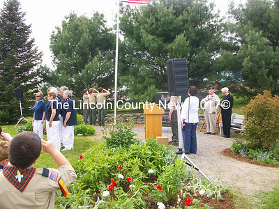 The Boy Scouts of Jefferson raise the flag for the Pledge of Allegiance while the Maine-ly Harmony Chorus perform the National Anthem during Memorial Day Ceremonies in Jefferson May 29. (Photo courtesy Trudi Hodgdon)