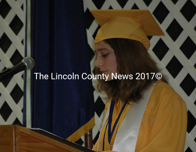 Valedictorian Lily Van Steenberg tells a story about falling while rock climbing to illustrate the importance of taking risks. (Samuel J. Baldwin photo)