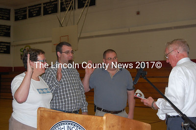 Newcastle moderator John Black administers the oath of office to (left to right) Selectmen Ellen Dickens and Ben Frey and school committee member Mark Doe. (J.W. Oliver photo)