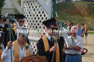 Class marshals Emma Lazzari and Benjamin Conary lead the processional. (J.W. Oliver photo)