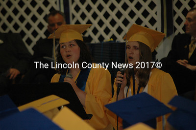 "Amber Massicotte, left, and Molly Parent sing ""By My Side"" at the MVHS graduation. (Samuel J. Baldwin photo)"