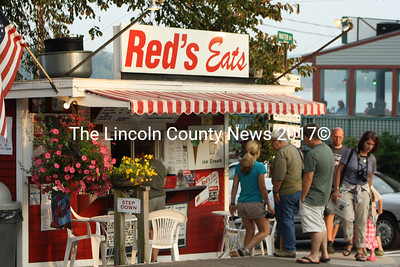 A small line at Reds Eats in Wiscasset on July 12. According to downtown merchants the summer season is finally rounding into form after a wet spring and heavy construction kept some vistors away. (Matthew Stilphen photo)