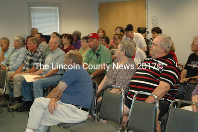 Relatives and plot owners in Sweetland Cemetery in Waldoboro gathered to discuss the cemetery's finacial problems on July 7 at the town office. (Samuel J. Baldwin photo)