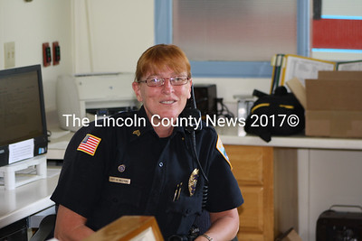 Wiscasset Police Sgt. Kathy Williams in her office July 11. in addition to her duties as police officer, Williams rehabiliates injured or abandoned wild animals in Lincoln County. (Matthew Stilphen photo)
