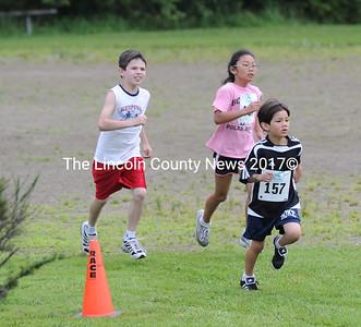 Fun Run runners approach the finish line at the Strawberry Shortcake Shuffle. (Paula Roberts photo)