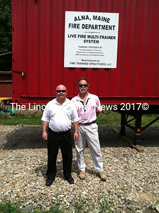 Lincoln County EMA Director Tim Pellerin (left) with Asst. to the Director Todd Hartung stand in front of a new live fire multi-trailer system in Wiscasset. (Matthew Stilphen photo)