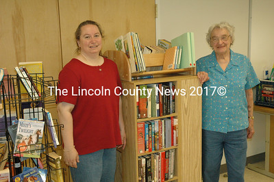 Jefferson Librarian Kathleen Stone, left, and volunteer Edie Stearns in the temporary Jefferson Public Library space at the Jefferson Fire Station. (Samuel J. Baldwin photo)