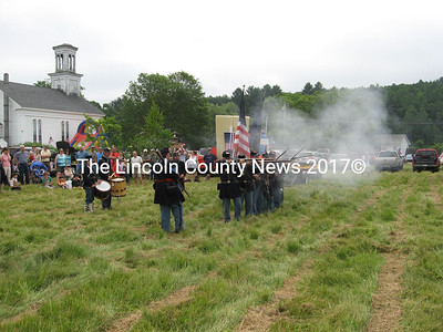 The Civil War infantry re-enactors fire their muskets behind Union Hall after Whitefield's parade. (Lucy Martin photo)