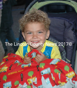 Tyler McGhee Thompson, 3, from Damariscotta came prepared with his favorite blanket. (Eleanor Cade Busby photo)