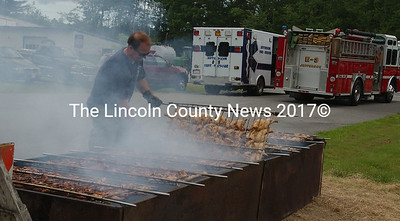 Darin Walker flips the chicken at Jefferson Fire and Rescue's annual chicken barbeque on Saturday.
