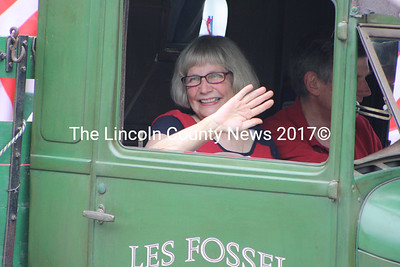 District 53 Rep. Les Fossel (R-Alna) pilots a truck while his wife Mary waves to the crowd during Wiscasset's Fourth of July Parade. (Matthew Stilphen photo)