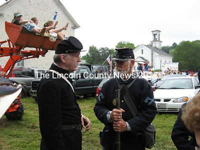 Charles McGillicuddy (left) chats with Dick Cylik, president of the Third Maine Regiment, Co., a re-enactment group. (Lucy Martin photo)