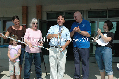 JVS Principal Peter Gallace, flanked by school board and PTO members, cuts a ceremonial ribbon at the entrance to the new JVS building. (Samuel J. Baldwin photo)