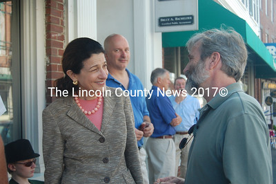 Snowe and Tomlin Coggeshall, of Newcastle, enjoy a friendly exchange on Main Street Aug. 18. (J.W. Oliver photo)