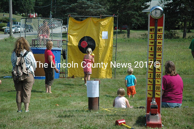 Ollie's Place, across the street from the school and town office, hosted a bouncy castle and carnival games as part of Jefferson Community Day. (Samuel J. Baldwin photo)