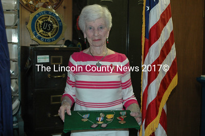 Gertrude Kane accepts the WWII Medals belonging to her husband Captain Edward P. Kane, and a copy of his dog tags, at The Wells-Hussey American Legion Post 42 in Damariscotta Monday evening.