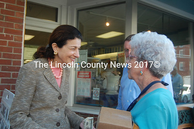 Joanne Jacobs, co-owner of Waltz Pharmacy, stops to greet U.S. Sen. Olympia Snowe on her way to the post office. (J.W. Oliver photo)
