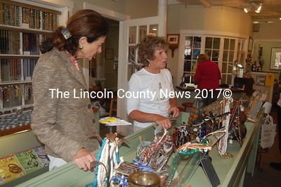 U.S. Sen. Olympia Snowe browses the selection at Aboca Beads with the expert guidance of co-owner Patty Palmer. (J.W. Oliver photo)