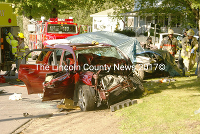 Two people were killed and another seriously injured in a three-car collision on Rt. 27, in Boothbay Aug. 23. According to Lincoln County Sheriff's Office, the accident occurred after a southbound car crossed the center line and struck a north bound car head on around 4:38 p.m. One driver was killed. The other driver sustained life-threatening injuries and a passenger in his vehicle was killed. A third car was damaged in the collision but both occupants avoided serious injury. (Steve Edwards photo)