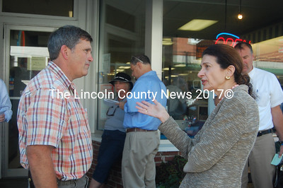 U.S. Sen. Olympia Snowe chats with Buzz Pinkham outside Waltz Pharmacy in Damariscotta. (J.W. Oliver photo)