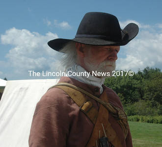 17th century re-enactor Ken Grant, of Elliot, heads off to find a libation. (E. Busby photo)