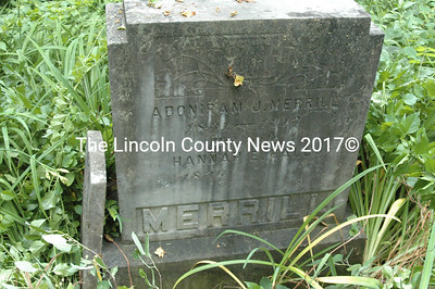 The headstone of Adoniram J. Merrill and his wife Hannah E. (Hall) is in good condition. The small, broken headstone of their young son Wendell leans against it.