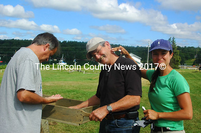 """Paul Giggey, with Dennis Jipson and his daughter Janice Jipson Bisson sift for artifacts. Dennis Jipson retired last year. Janice said, """"I thought the adventure of participating in the Colonial Pemaquid dig would be a great shared experience."""" (E Busby photo)"""