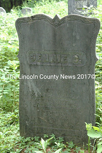 The headstone of Jennie C. (Merrill) Hall has intricate carving along its edges. Jennie was the youngest child of Benjamin and Patience Merrill.