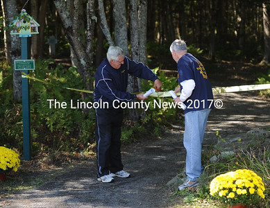 Neil Lash and George Gould cut the ribbon to open  the Neil W. Lash Nature Trail during Medomak Valley's Homecoming on Saturday.