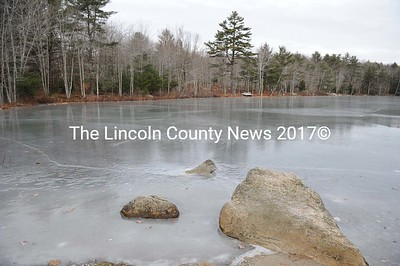 New coat of ice on Pinkham's Pond in Alna.