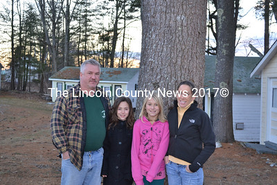 Photographed (l-r) are Brian Cookson, his daughter Aubree Cookson, her friend Samantha Winchenbach, and Cindy Landry. Cookson and Landry plan to totally refurbish each cabin to create a cozy atmosphere for guests. (A. Brodsky photo)