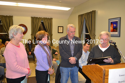 Board of Selectmen Chair Judy Colby (right) presents the Stetson Family, owners of the Wiscasset Old General Store, a Business Recognition Award Jan. 3. . (A. Brodsky photo)