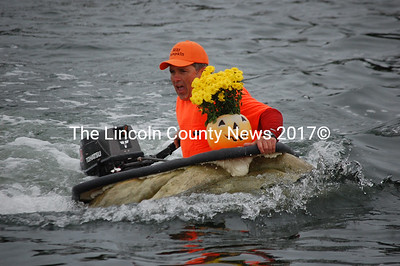 Damariscotta Pumpkinfest co-founder Buzz Pinkham competes in the regatta. (J.W. Oliver photo)