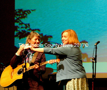 """Sylvia Tavares and friend prepare to sing Dave Van Ronk's """"Watching the River Run."""""""