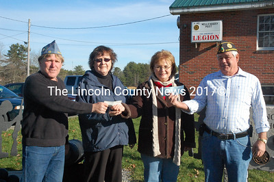 Wells-Hussey American Legion Post 42 presented donations to the Ecumenical Food Pantry Nov. 16. Sons of the American Legion Cmdr. James Herald (left), American Legion Auxiliary President Mary Fish (second from left) and American Legion Vice Cmdr. Bruce Poland (right) hand checks to Newcastle Food Pantry co-chairwoman Jane Najim. Najim said she is grateful for the donors' service to the country and the community. (J.W. Oliver photo)
