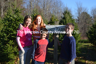 Students (from left): Christine Hilton, Jennifer Arter, Tayler Warren, and Brian McLaughlin all have trees growing in the Great Salt Bay Community School Tree Farm. (D. Lobkowicz photo)