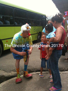 The legendary Dr. Patch Adams greets a family in Costa Rica.