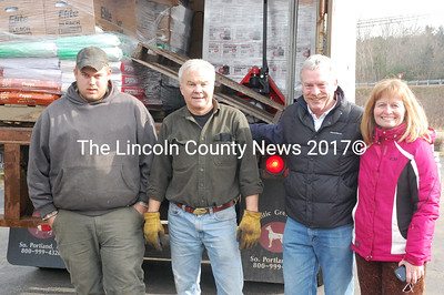 From left to right, Derek Brilyea of Louis Doe Home Center and local Hurricane Sandy relief coordinators Larry Sidelinger, Russ Williams and Anne Geisler pose with a semitrailer full of supplies for families in New York City. The crew had just finished loading pallets of cleaning and construction supplies and pet food from the Newcastle hardware store. The store donated some of the items, while others were purchased by fellow businesses and charities, including the Damariscotta-Newcastle Rotary Club and Lincoln County Publishing Company. (J.W. Oliver photo)